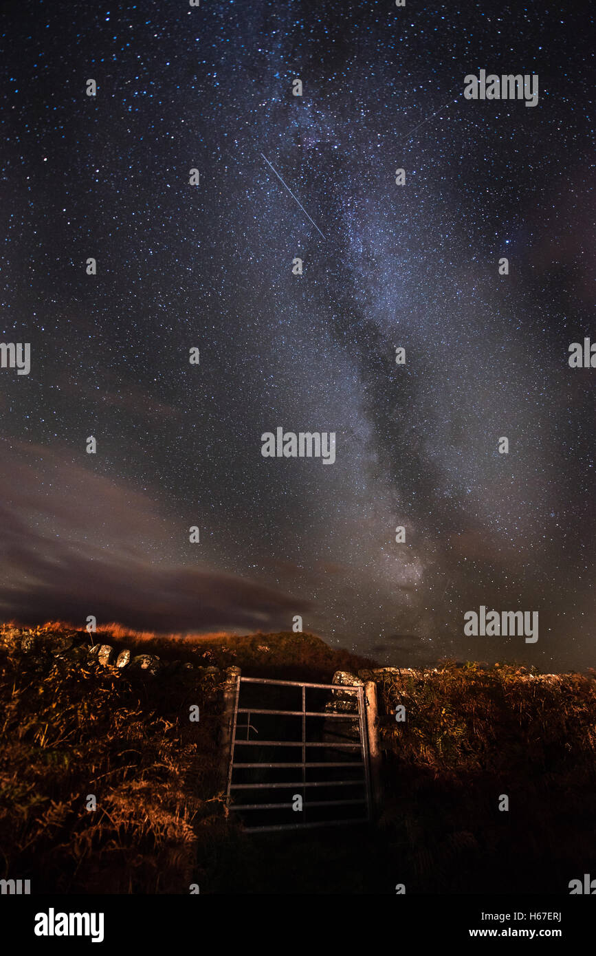 The Milky Way and Orionid Meteor shower over the night skies above the Dark Skies Park in Galloway, Scotland - Stock Image