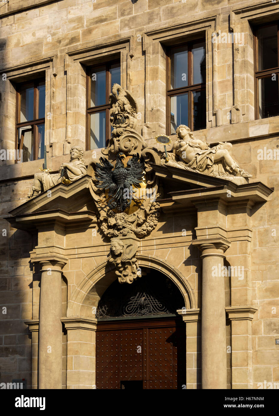 Ornate pediment over doorway of the town hall, Nuremberg. - Stock Image