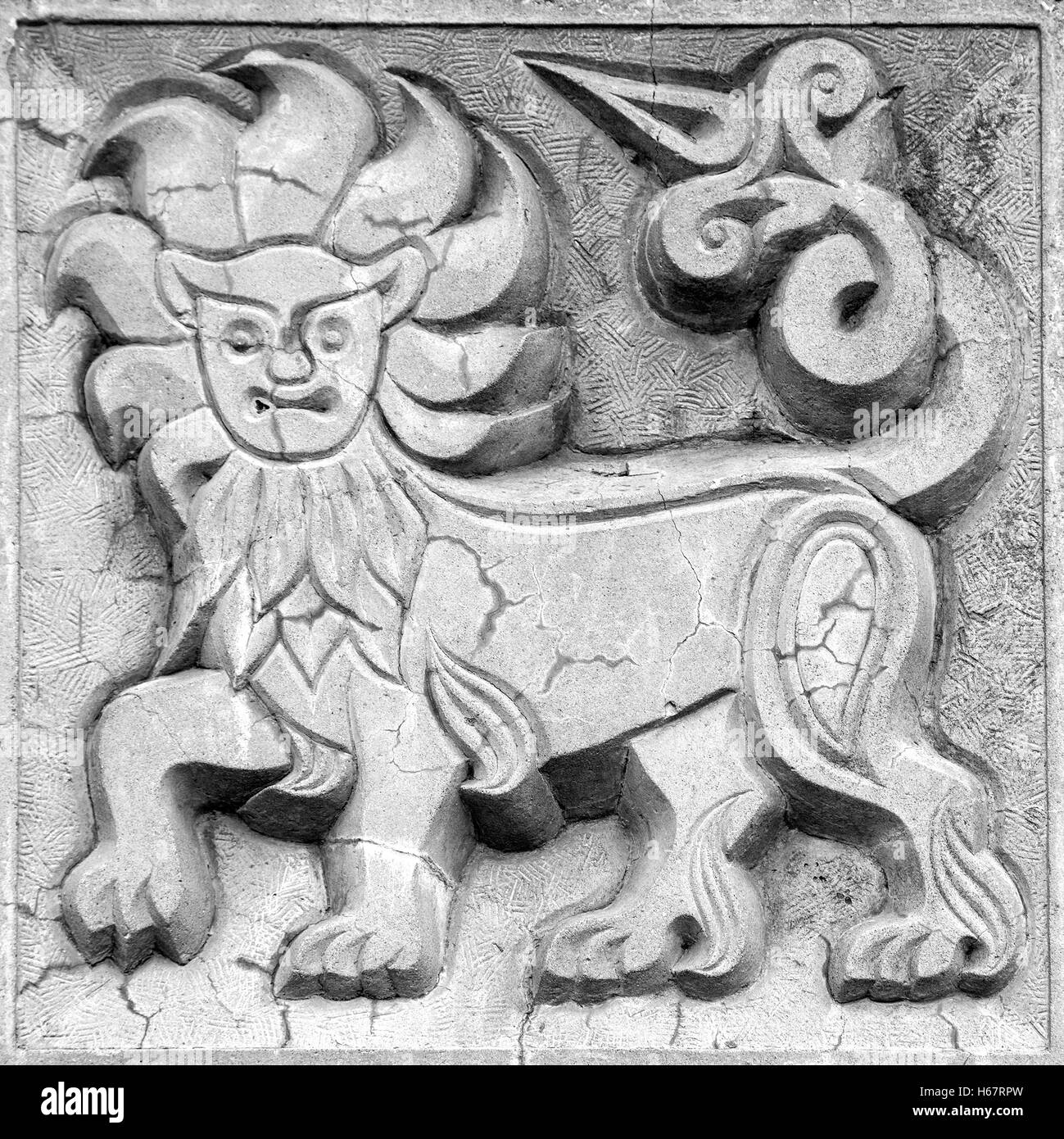 big fabulous lion, stone bas-relief on the wall - Stock Image