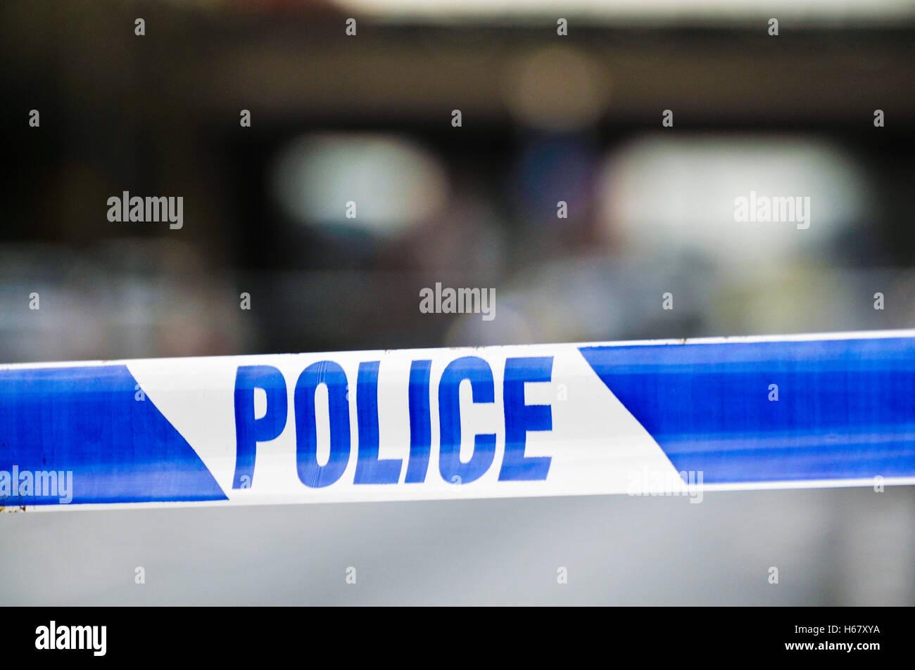 Police tape at the cordon of a crime scene. - Stock Image
