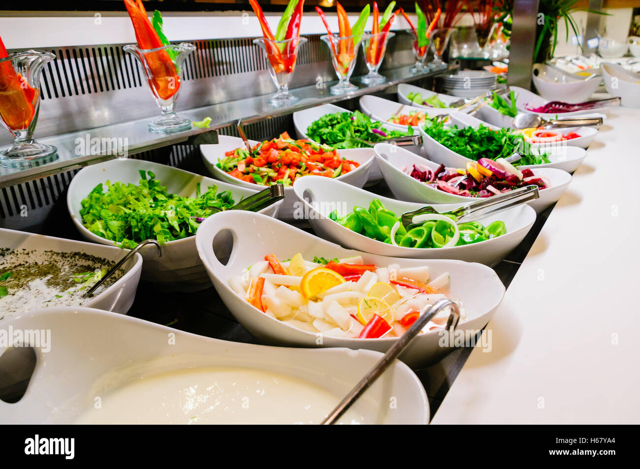 Bowls of salad at the buffet of a hotel restaurant Stock Photo