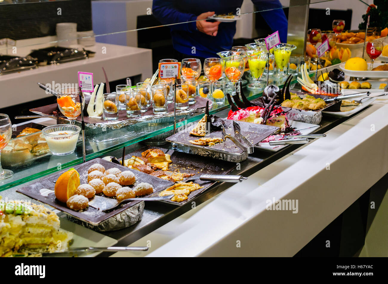 Dessets consisting of cakes, mousses and fruit at the buffet of a hotel restaurant Stock Photo