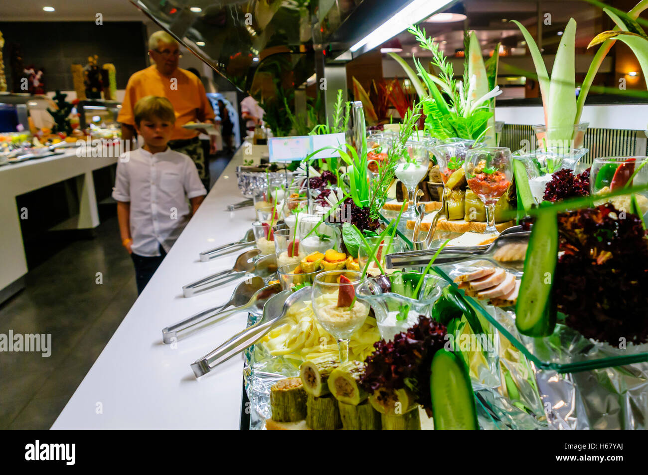 Large selection of cheese with ornate decoration at the buffet of a hotel restaurant Stock Photo