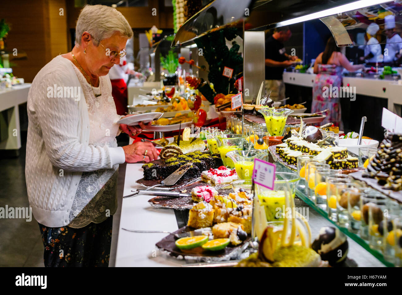 Dessets consisting of cakes, mousses and fruit at the buffet of a hotel restaurant - Stock Image
