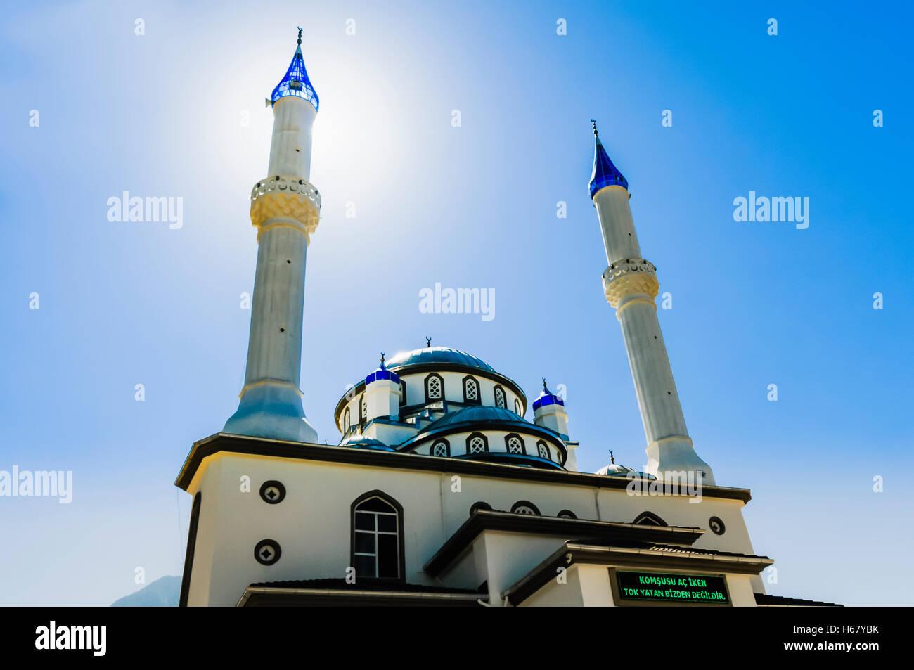 Sun Behind The Minaret Of A Mosque