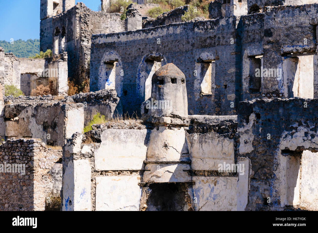Ruins at the former Greek village of Kayakoy in Turkey, abandoned 1922, now a museum and also known as the Ghost Stock Photo