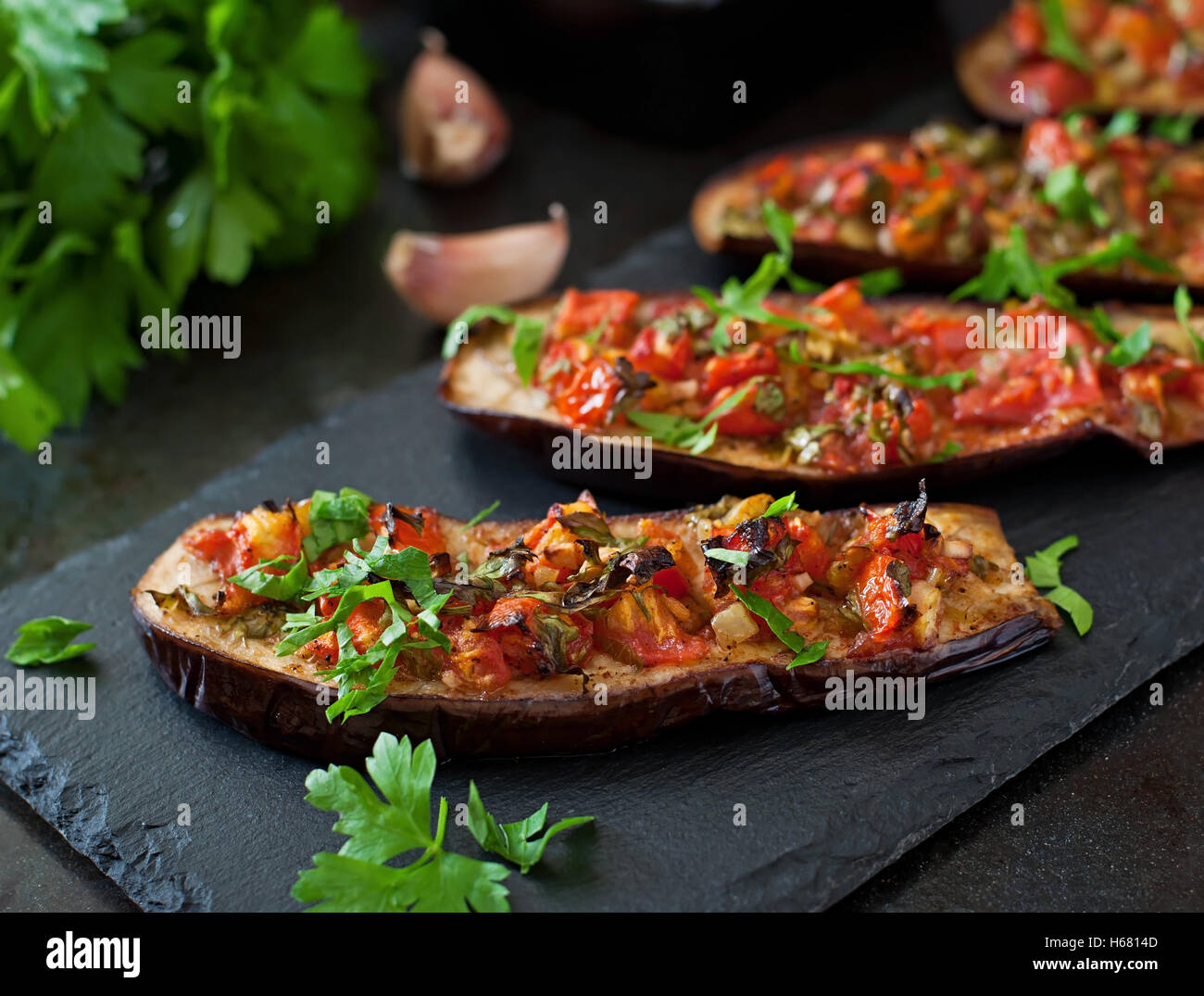 Baked eggplant with tomatoes, garlic and paprika - Stock Image