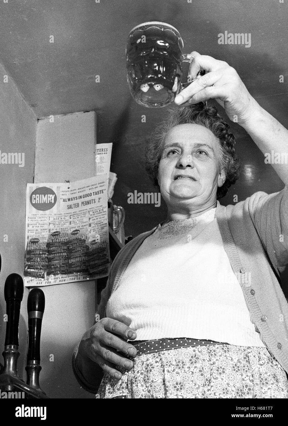 The landlady of the All Nations pub  in Madeley Shropshire Mrs Lewis brewing home made ale beer in 1962 - Stock Image