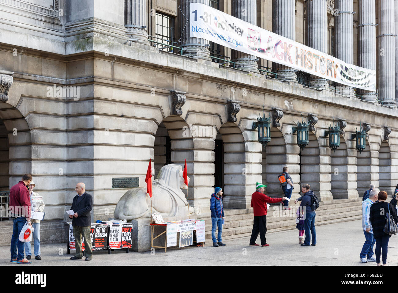 Activists handing out leaflets on behalf of Socialist Worker. In Nottingham, England. - Stock Image