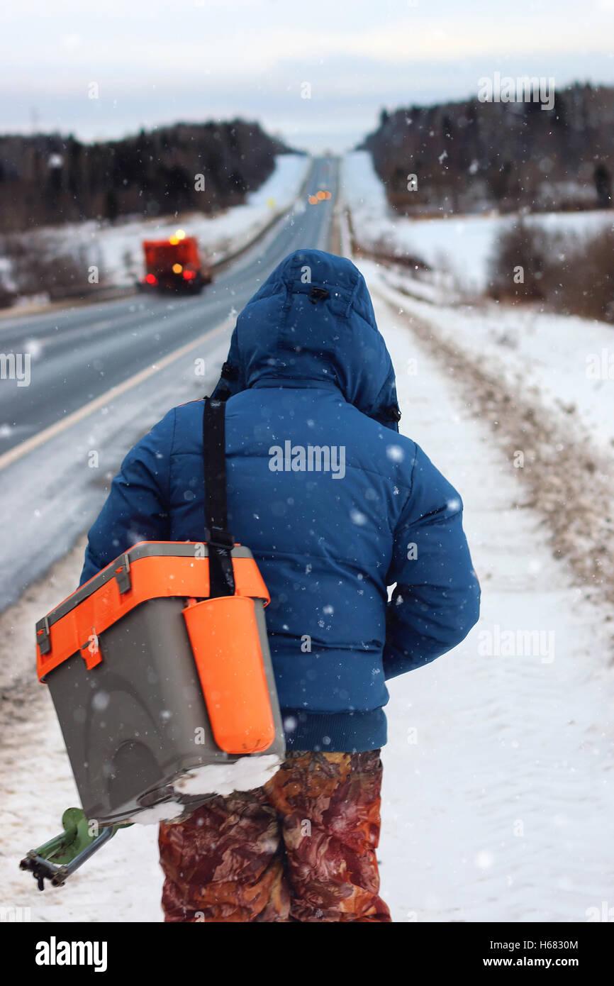 Winter fisherman walk fishing Stock Photo