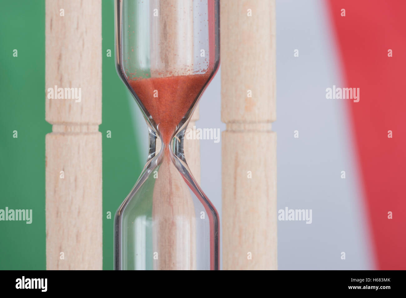 Italian flag with egg timer - metaphor for concept of time running out for Italy / Italian banking, financial bailout, - Stock Image