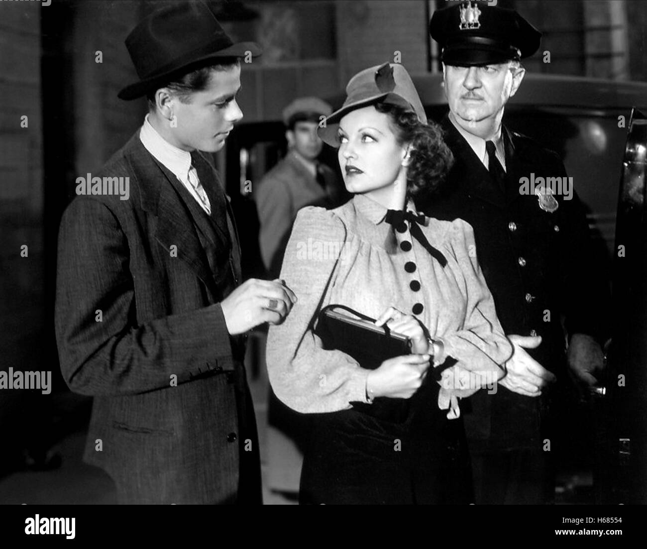 GLENN FORD & ROCHELLE HUDSON CONVICTED WOMAN (1940) - Stock Image