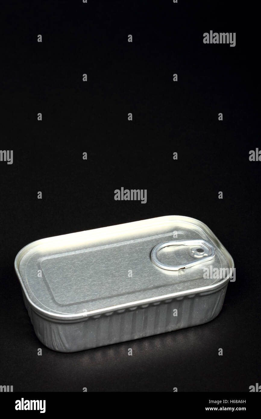 Metal steel sardine can conceptual use for claustrophobia confined space and being trapped - Stock Image
