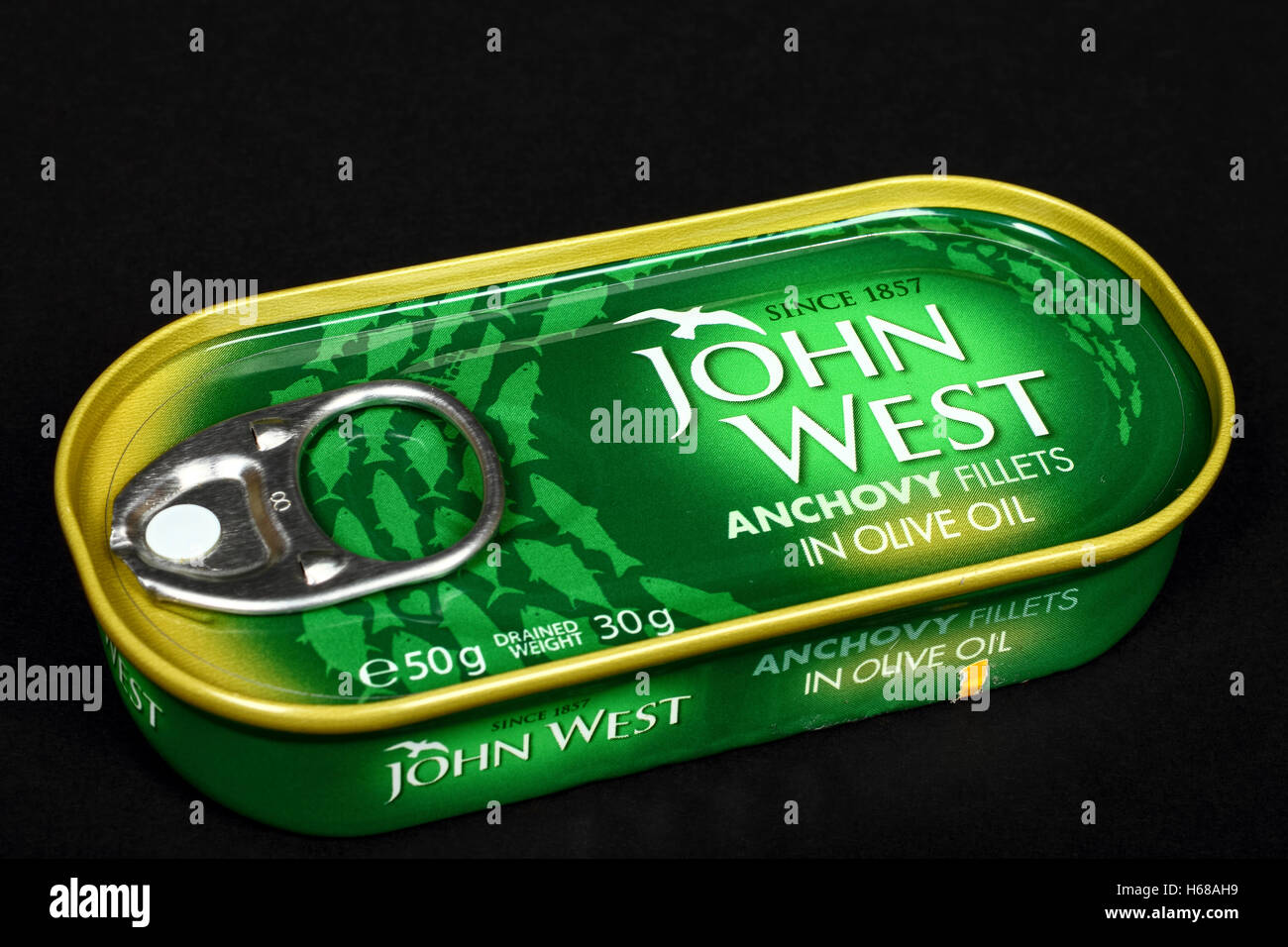 John west tinned anchovies isolated on a black background - Stock Image