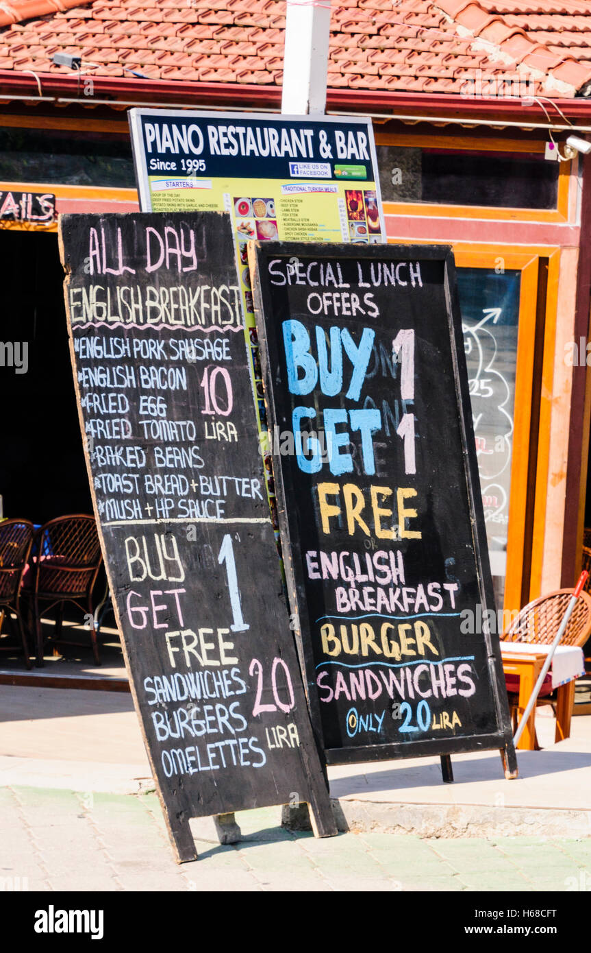 Blackboards outside restaurant and bar in a holiday resort, advertising all day English breakfast, sandwiches, burgers, - Stock Image