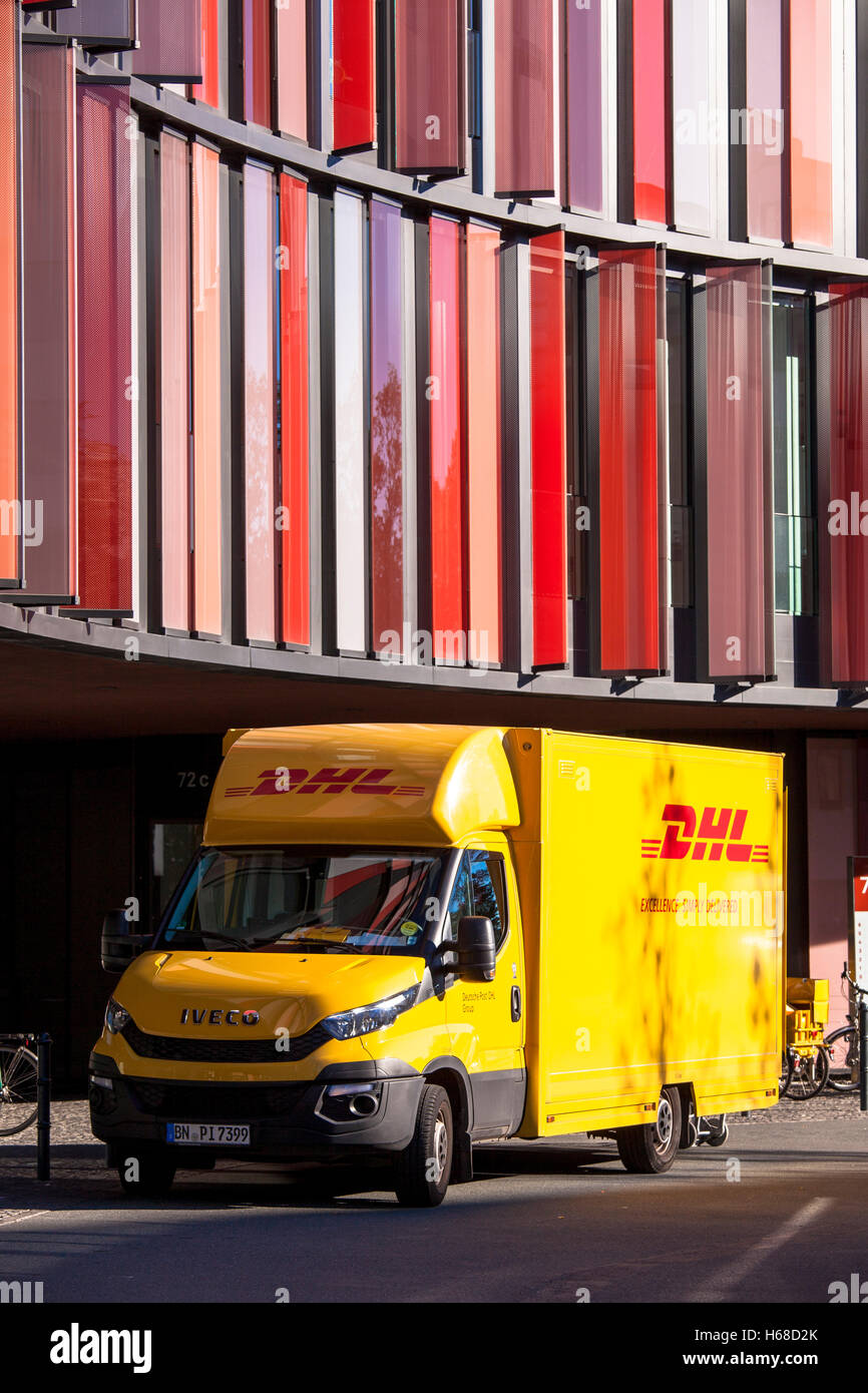 Germany, Cologne, DHL parcel service car in front of the office building Cologne Oval Offices. Stock Photo