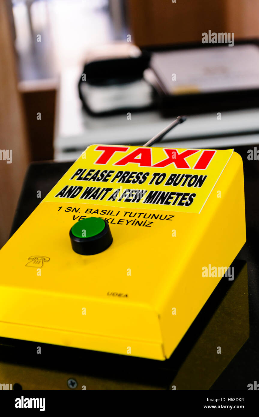 Remote control button to request a taxi at a Turkish hotel. - Stock Image