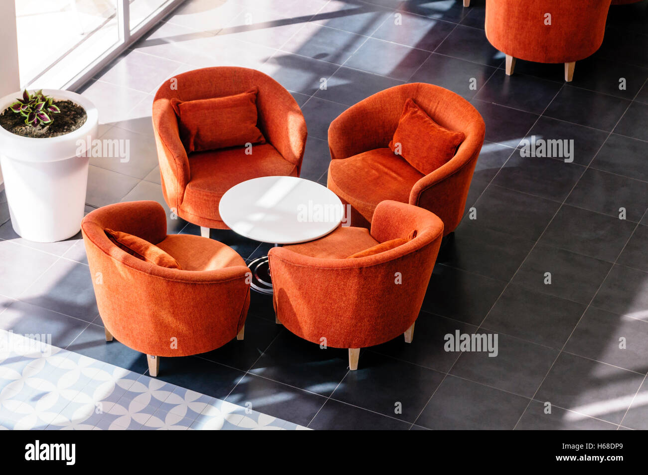 Orange Chairs And Table In A Hotel Lobby Stock Photo Alamy