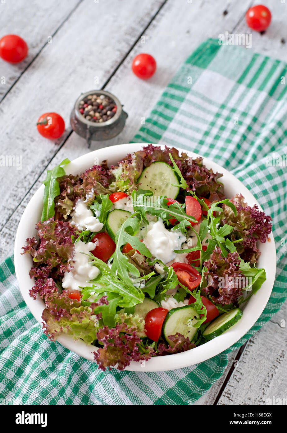 Useful dietary salad with cottage cheese, herbs and vegetables - Stock Image