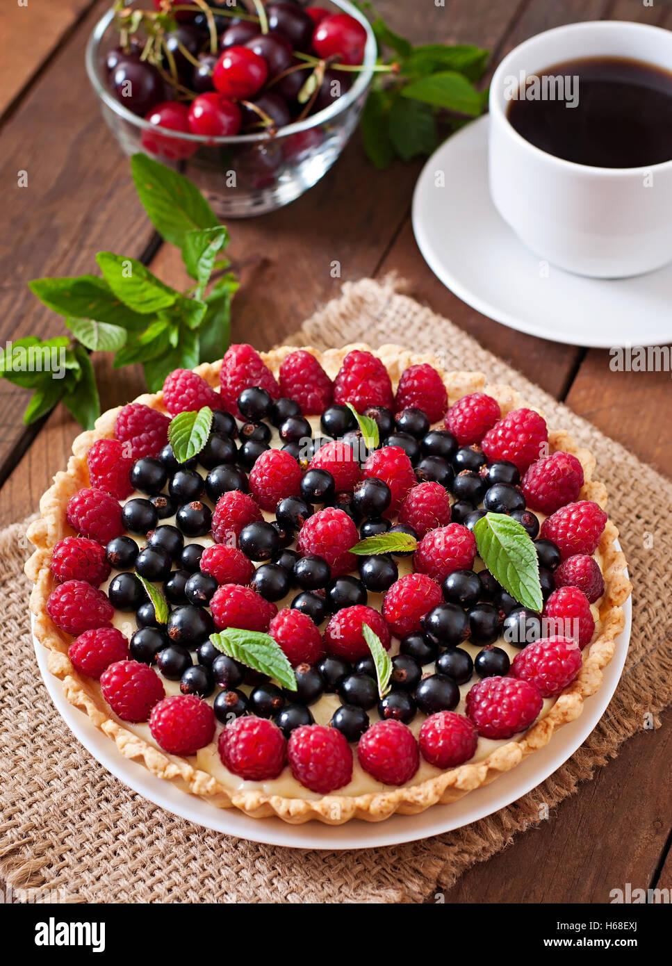 Tart with berries and custard. - Stock Image