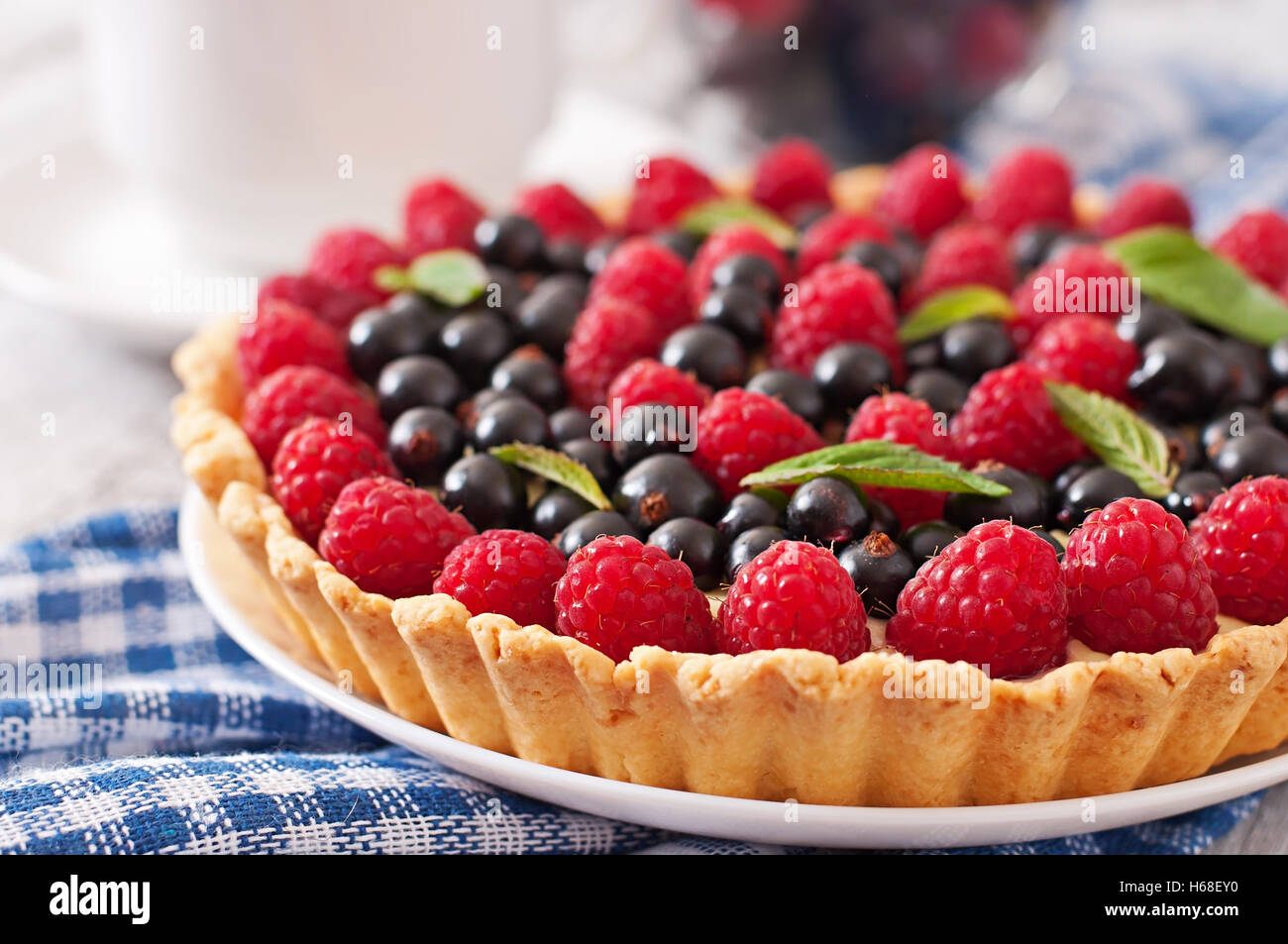 Tart with berries and custard. - Stock Image