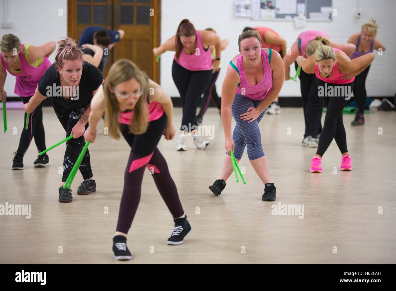 Women participating in POUND fitness class, hour long workout drumming which increases core strength, Surrey, UK - Stock Image