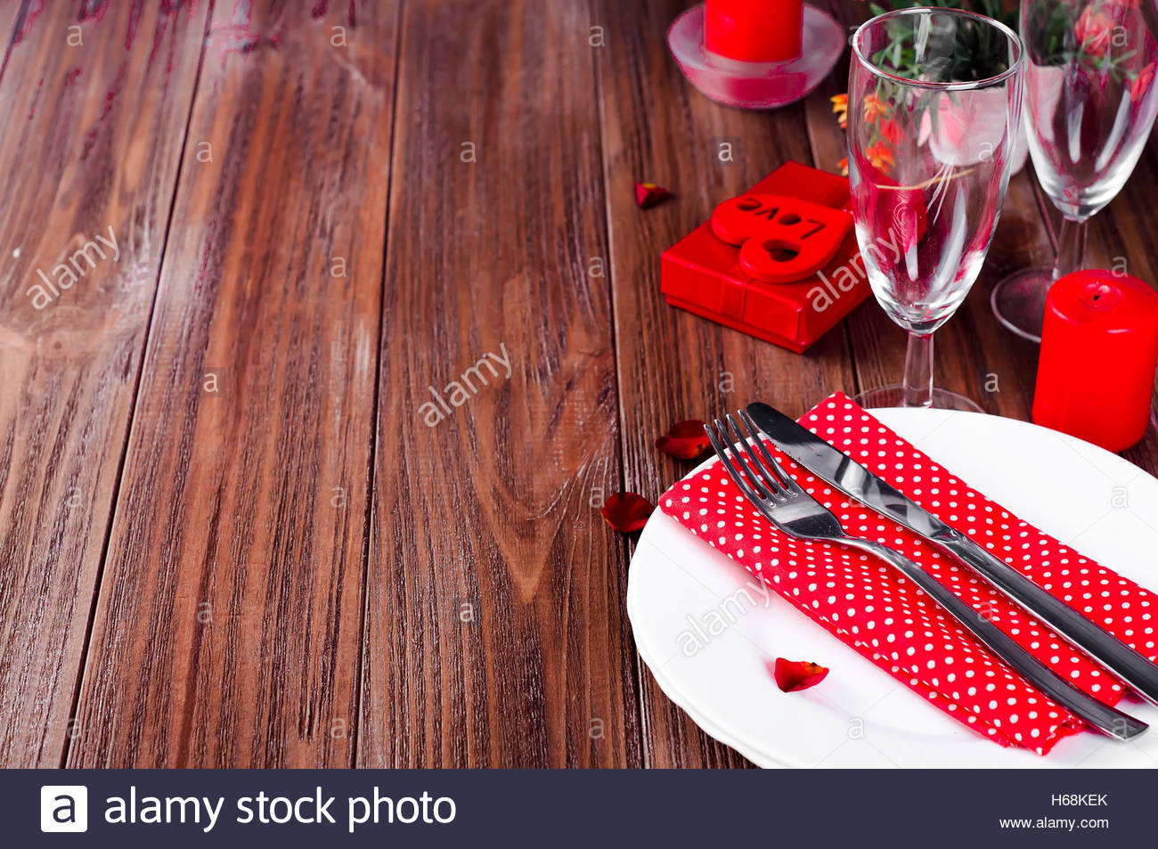 dinner table background. Romantic Valentine Candle Light Dinner Table Setting With Red Roses, Gift And Burning Candles Against A Brown Background. Background R