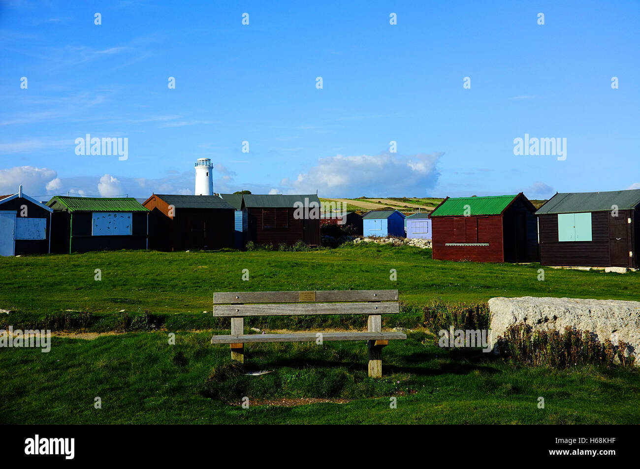 Old lighthouse and Fisherman Huts in Portland - Stock Image