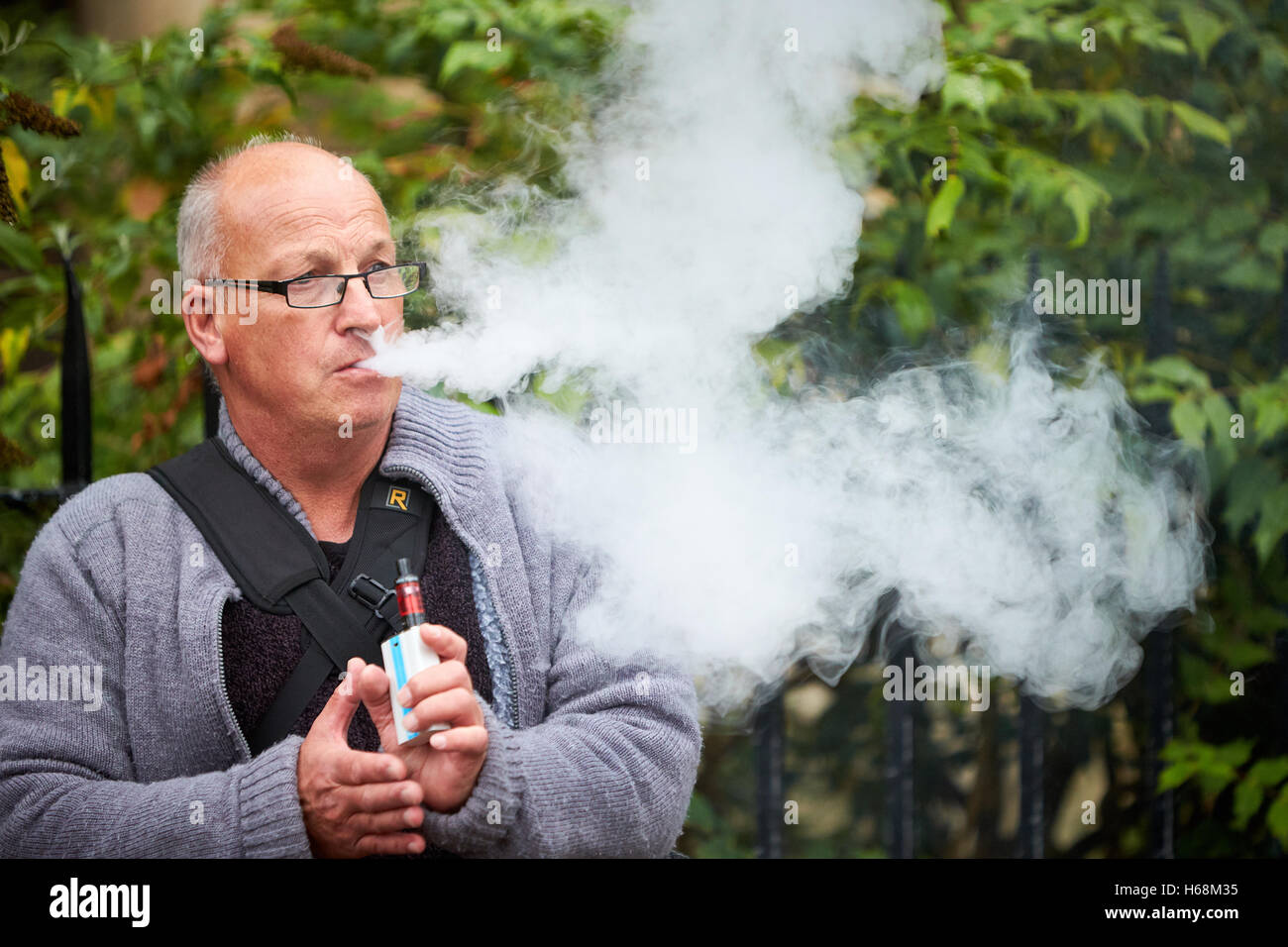 A man vaping - Stock Image