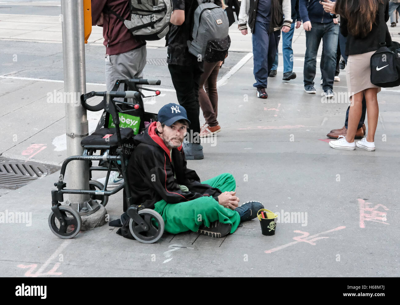 Disabled homeless man seen in front of his disabled chair, looking ...