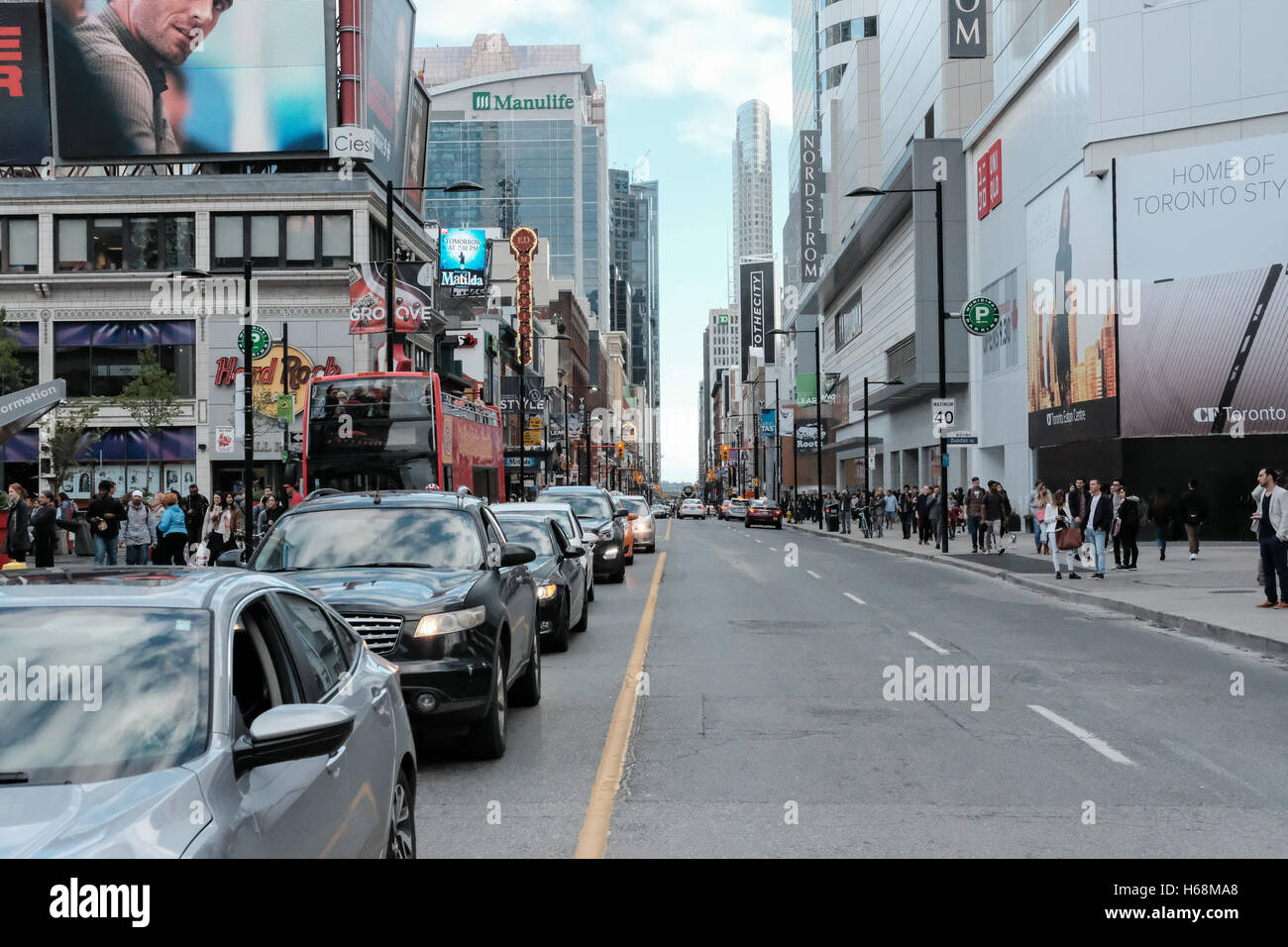 Heavy traffic congestion in a busy Toronto, Canada. The exit to the city is completely empty. - Stock Image