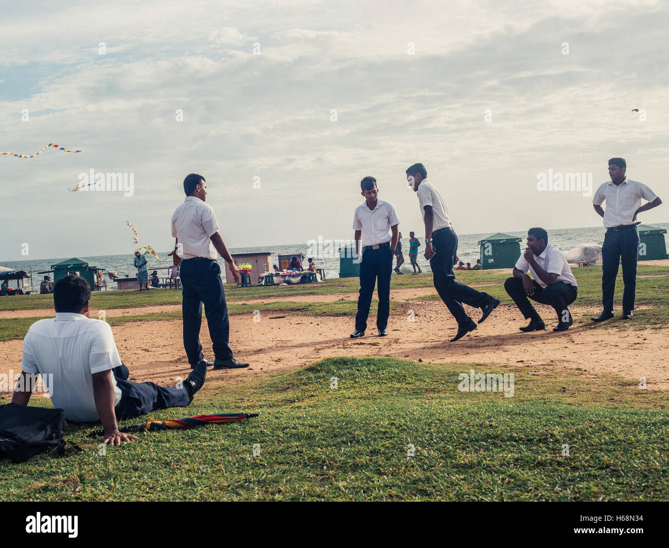 Colombo, Sri Lanka. June 10th 2016. Schoolboys play a game of hop-scotch on Galle Face Green, Sri Lanka. Stock Photo