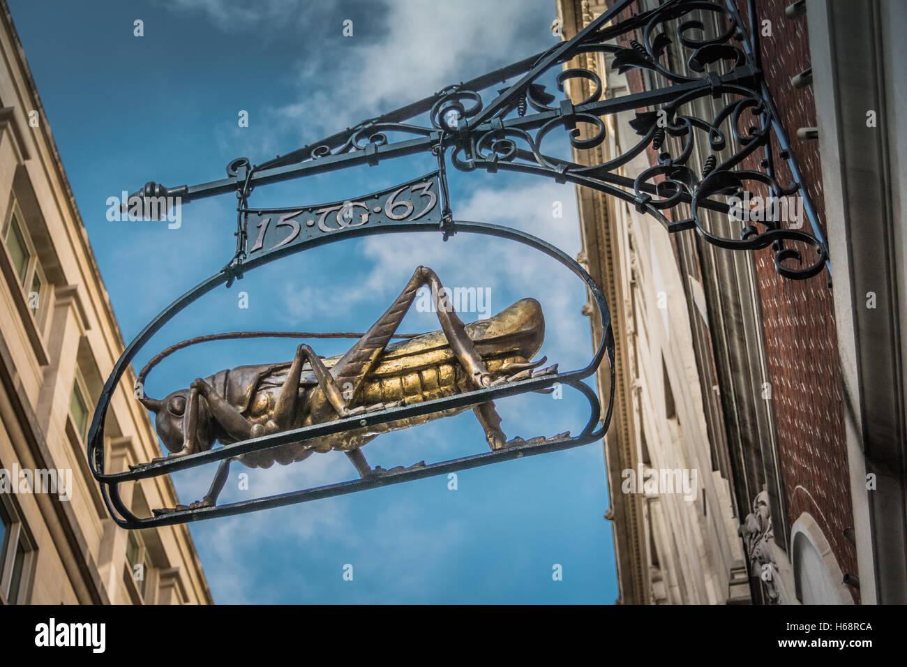 The Gresham gilded grasshopper at 68 Lombard Street, London, EC3, UK - Stock Image