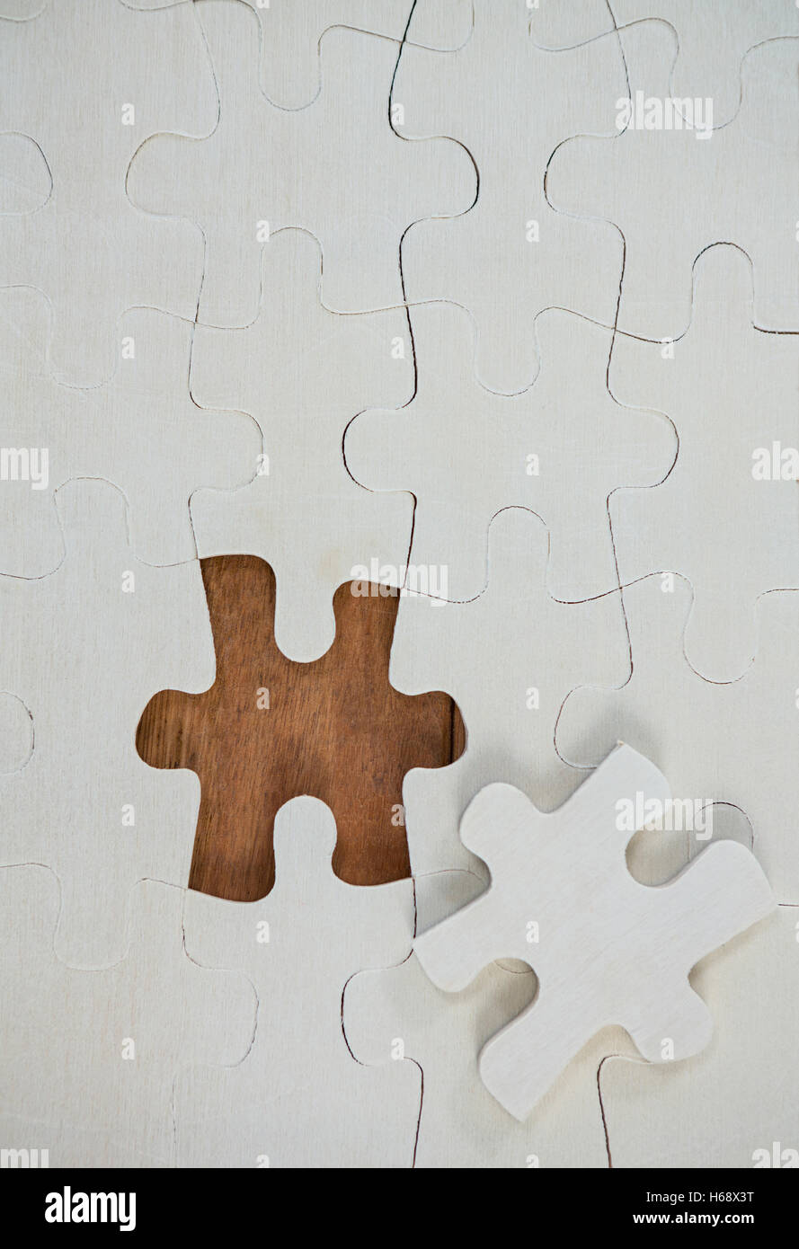 Jigsaw puzzle with one piece separately - Stock Image