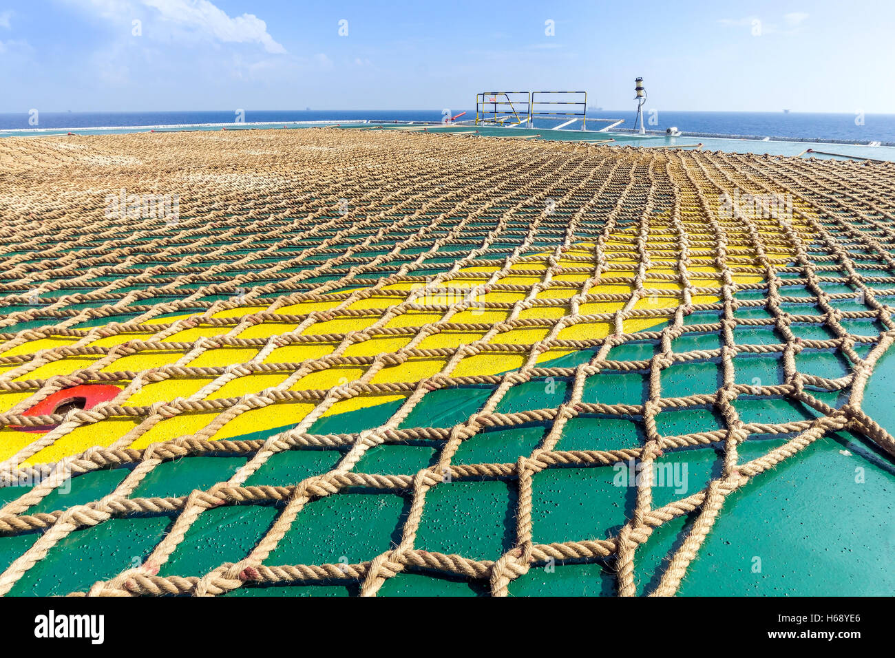 Netting on a helideck of an installation barge - Stock Image