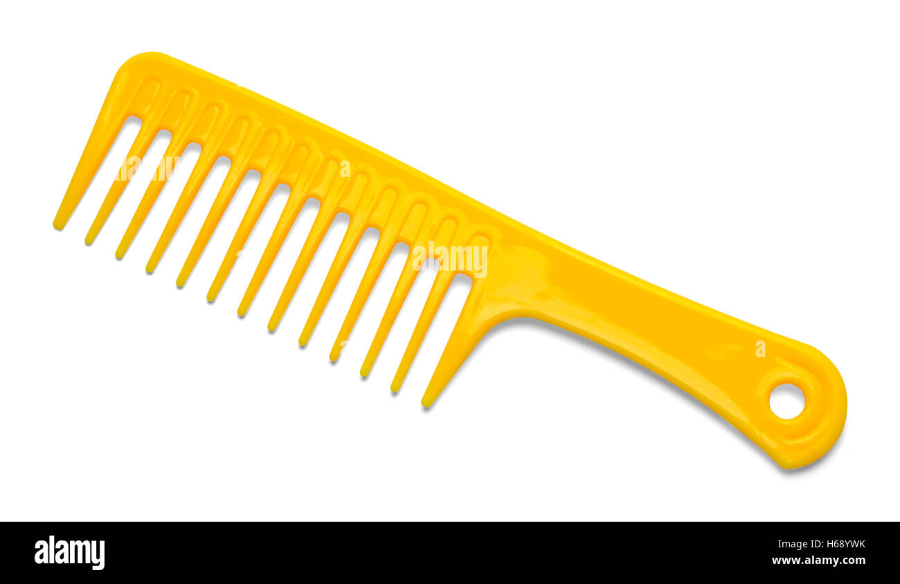 Large Yellow Plastic Comb Isolated on White Background. - Stock Image