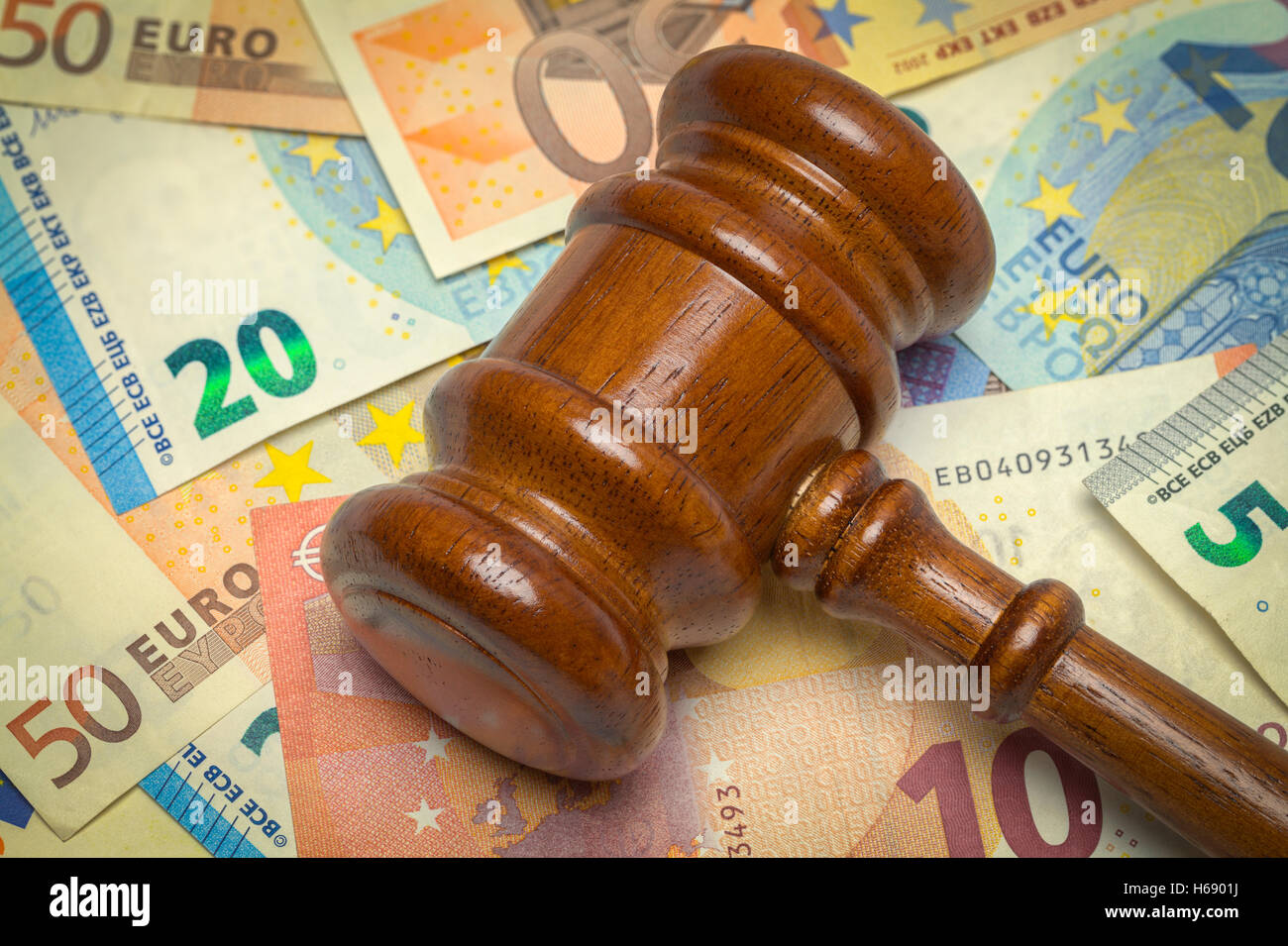 Pile of Euros and Wooden Law Gavel. - Stock Image