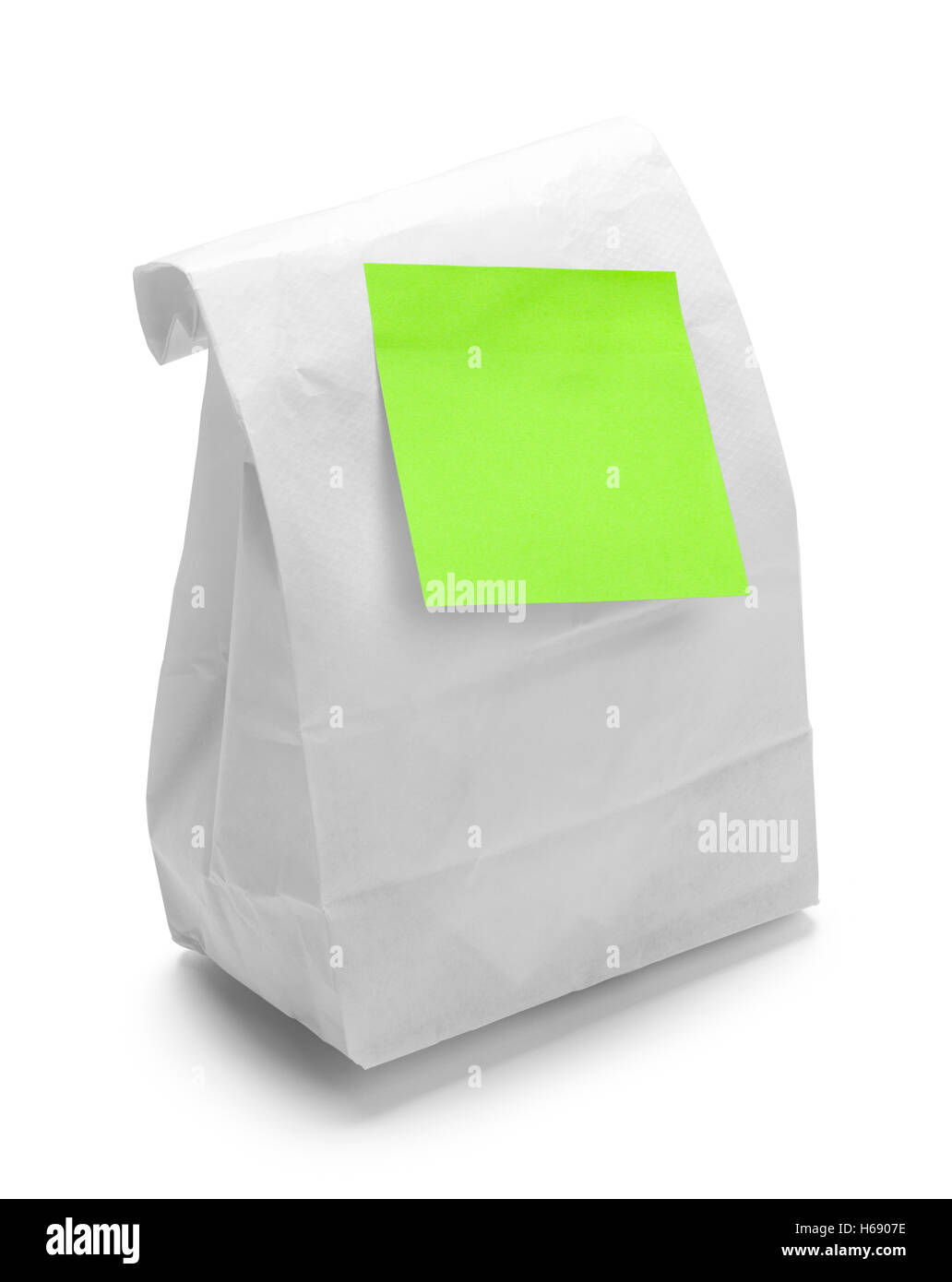 Sack Lunch with Green Sticky Note Isolated on White Background. - Stock Image