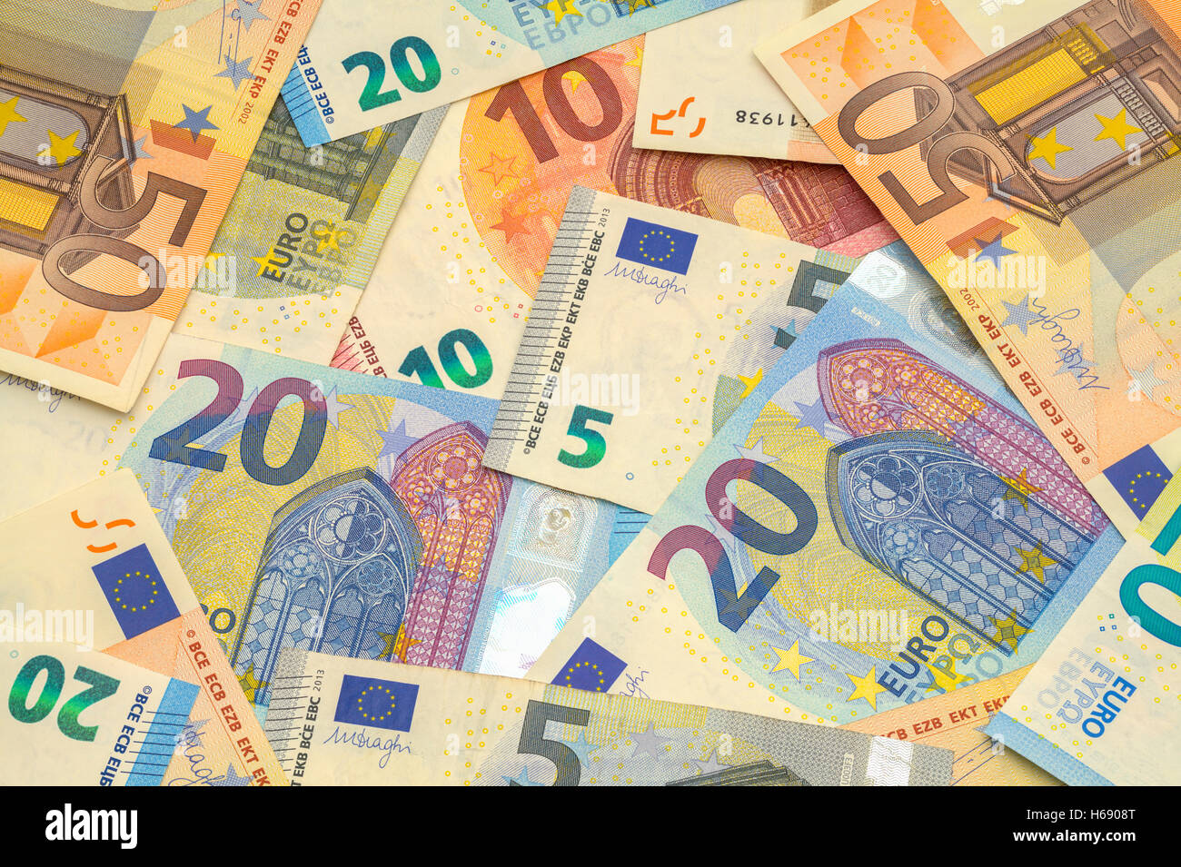 Scattered Pile of Euros with Various Bills. - Stock Image