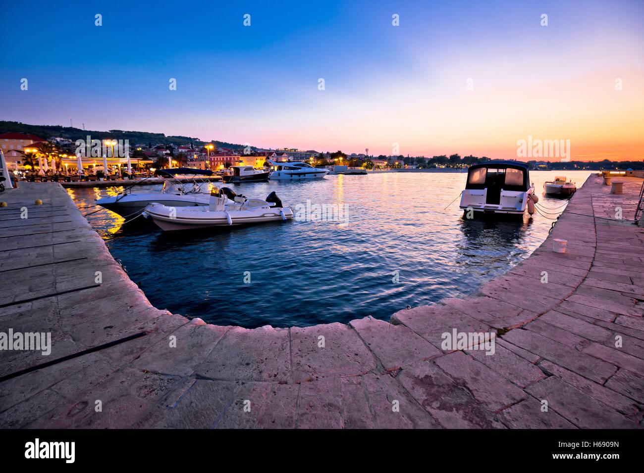 Supetar waterfront and harbor evening view, island of Brac, Dalmatia, Croatia - Stock Image