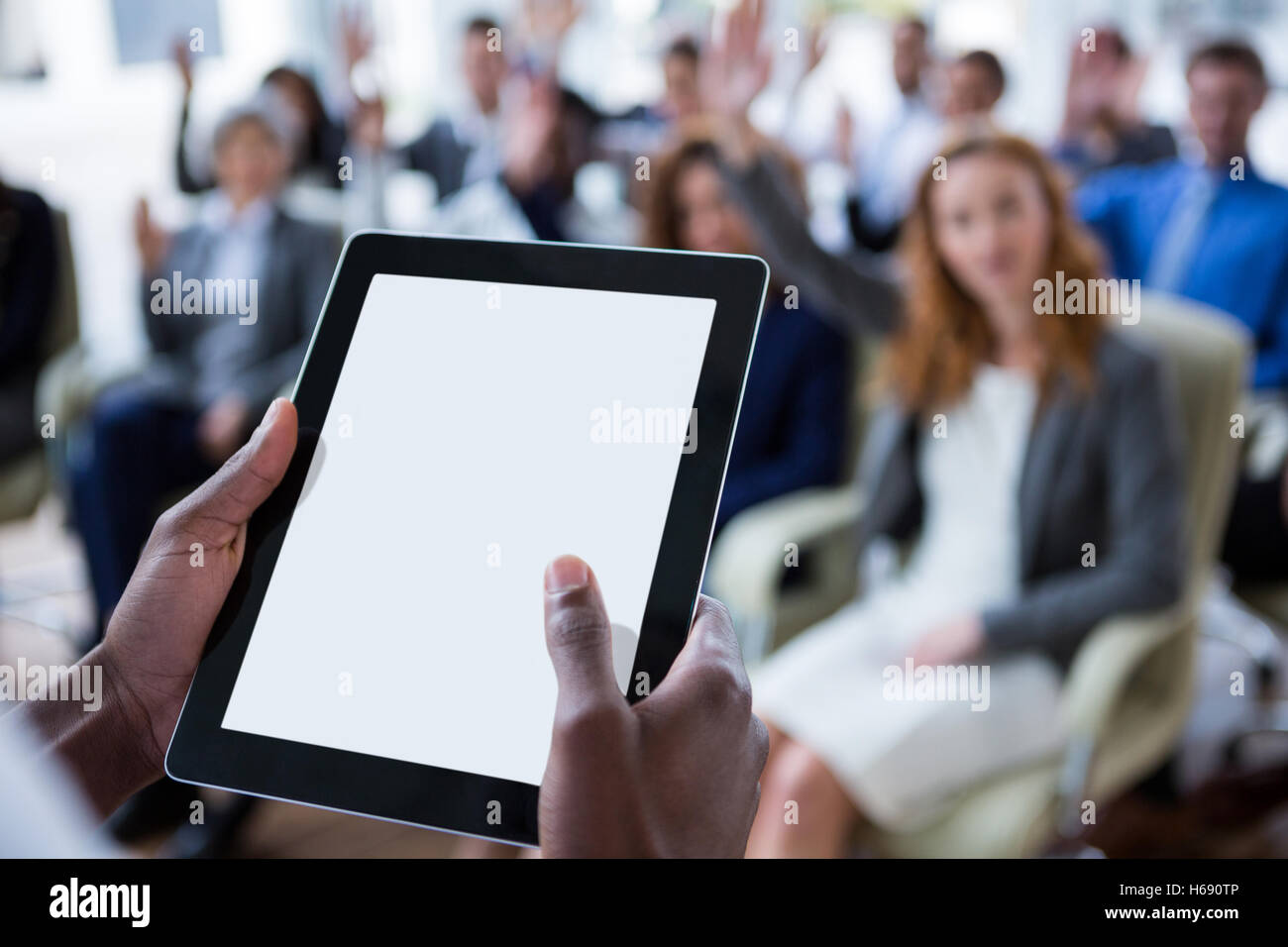 Businessperson using digital tablet during meeting - Stock Image