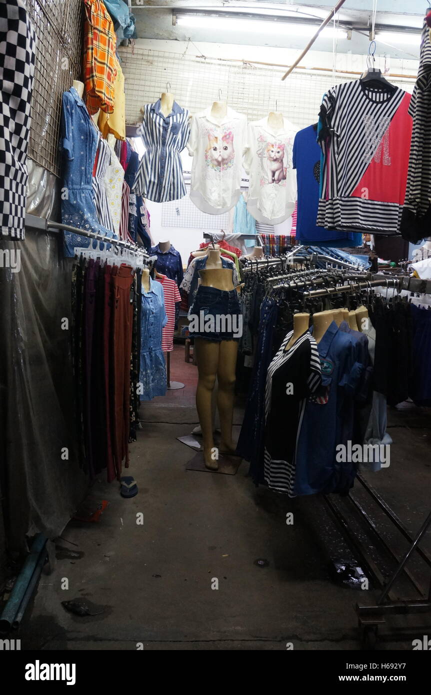 A clothing stall in a night market in On Nut, Bangkok, Thailand. - Stock Image