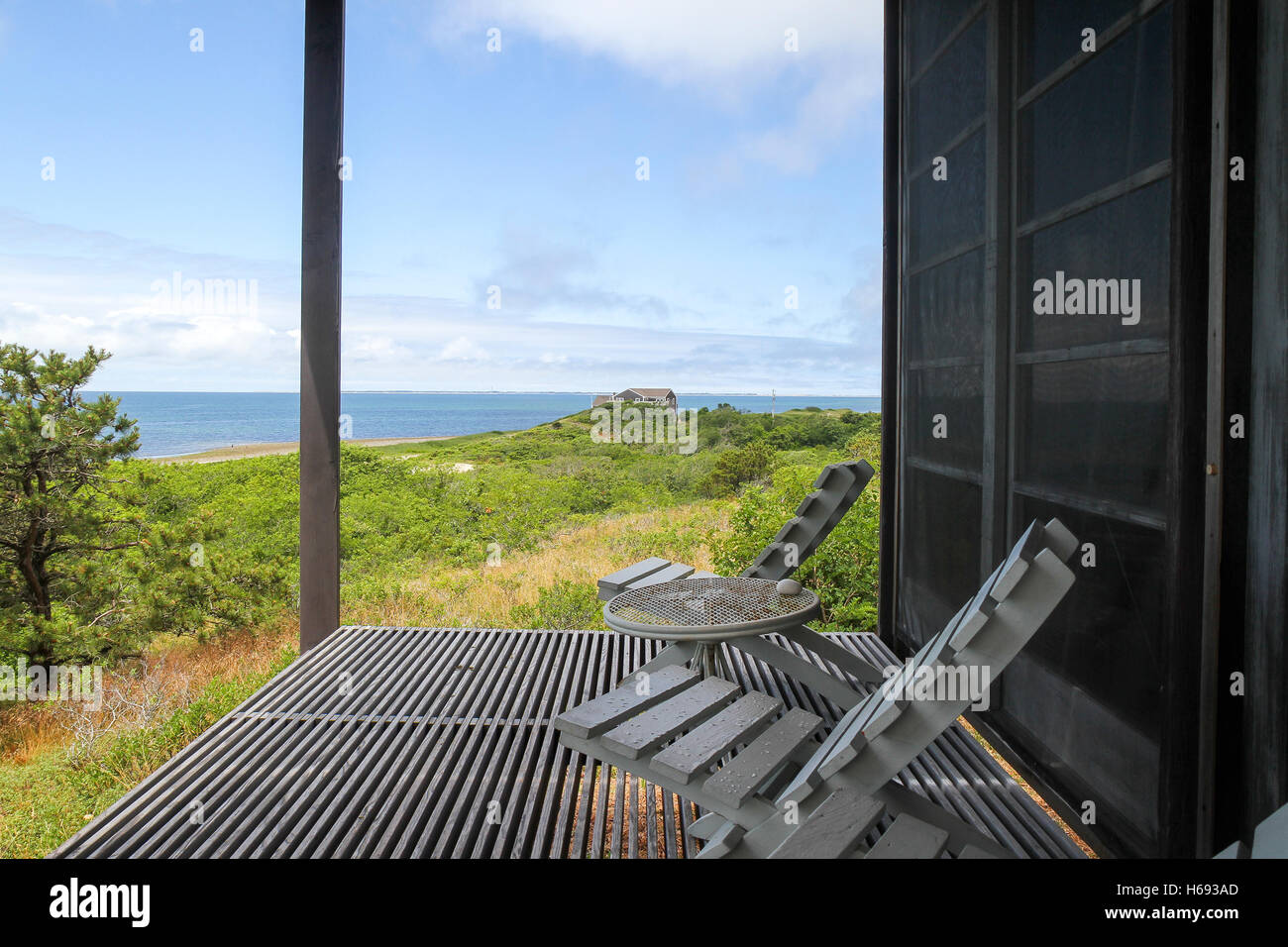 Porch overlooking the ocean at the Hatch Cottage, Wellfleet, Cape Cod, Massachusetts - Stock Image