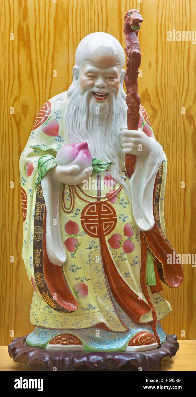 AVILA, SPAIN, APRIL - 18, 2016: The chinese porcelain Famille Rose figure of Tao Lucky Gods (Longevity - Shou) - Stock Image