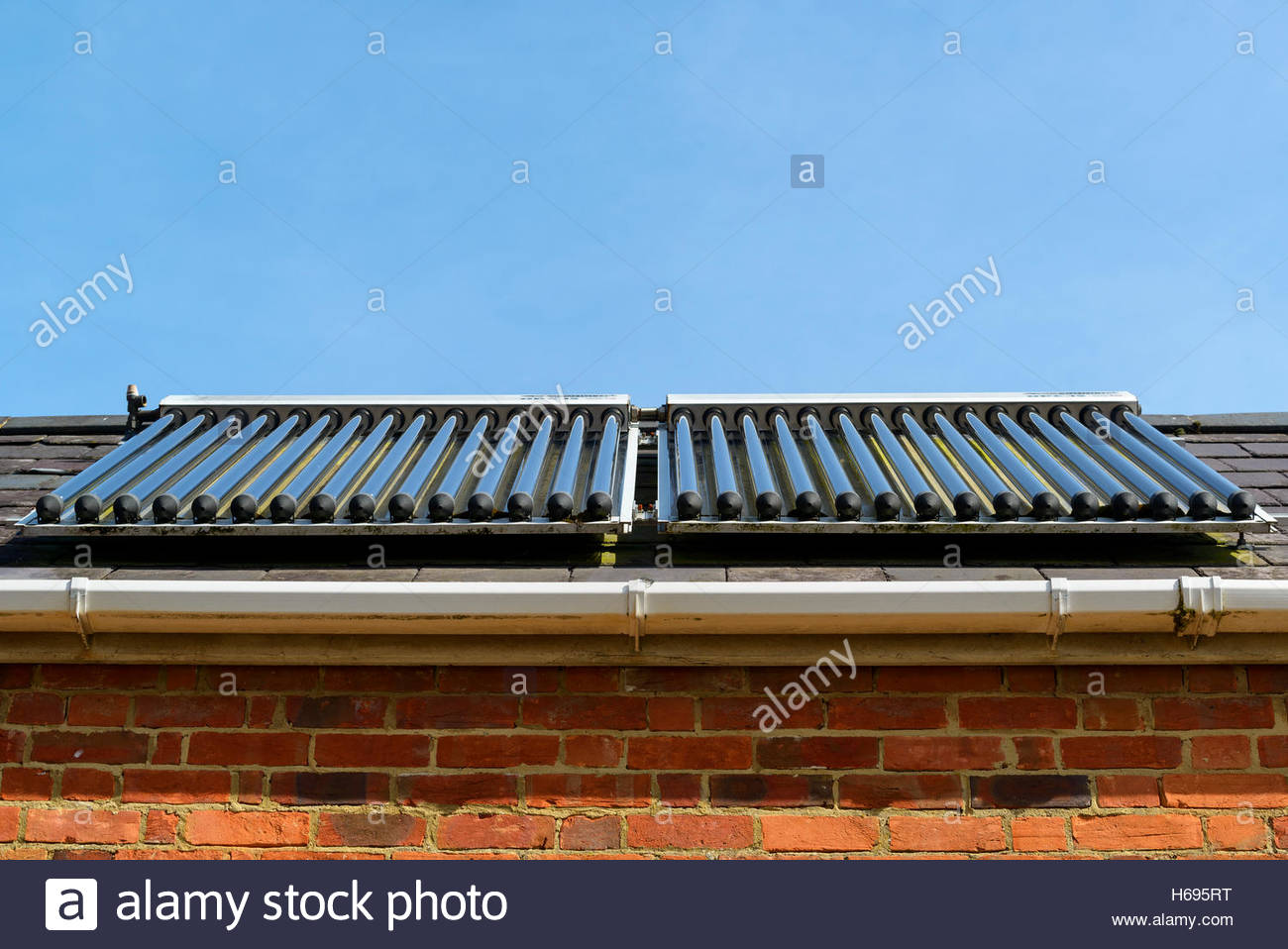 Solar evacuated tube collector panels, Dorset, England, Britain, UK - Stock Image