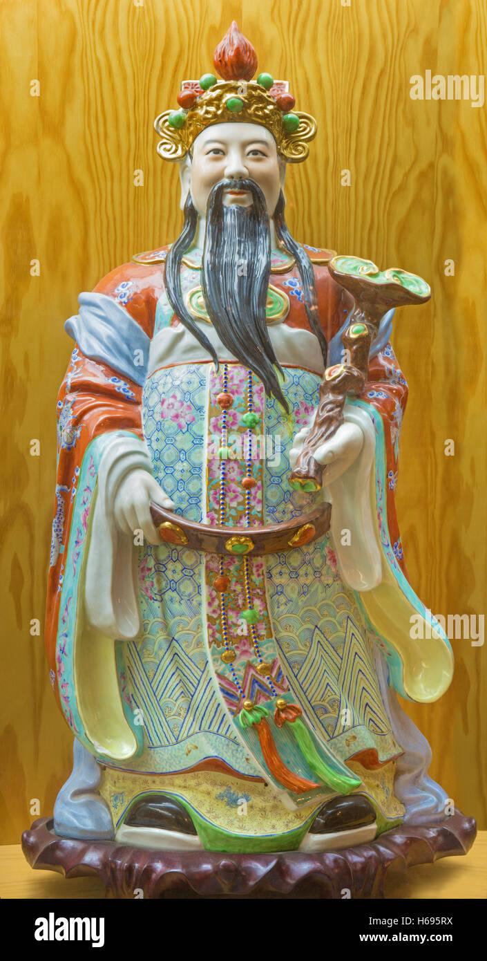 AVILA, SPAIN, APRIL - 18, 2016: The chinese porcelain Famille Rose figure of Tao Lucky Gods (Prosperity - Fu) - Stock Image