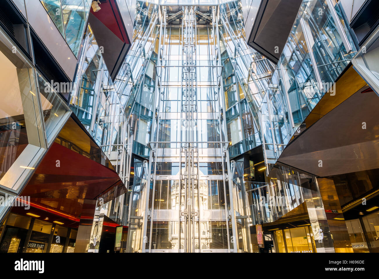 London, UK - August 06, 2016 - The central lifts of the shopping centre in One New Change building - Stock Image