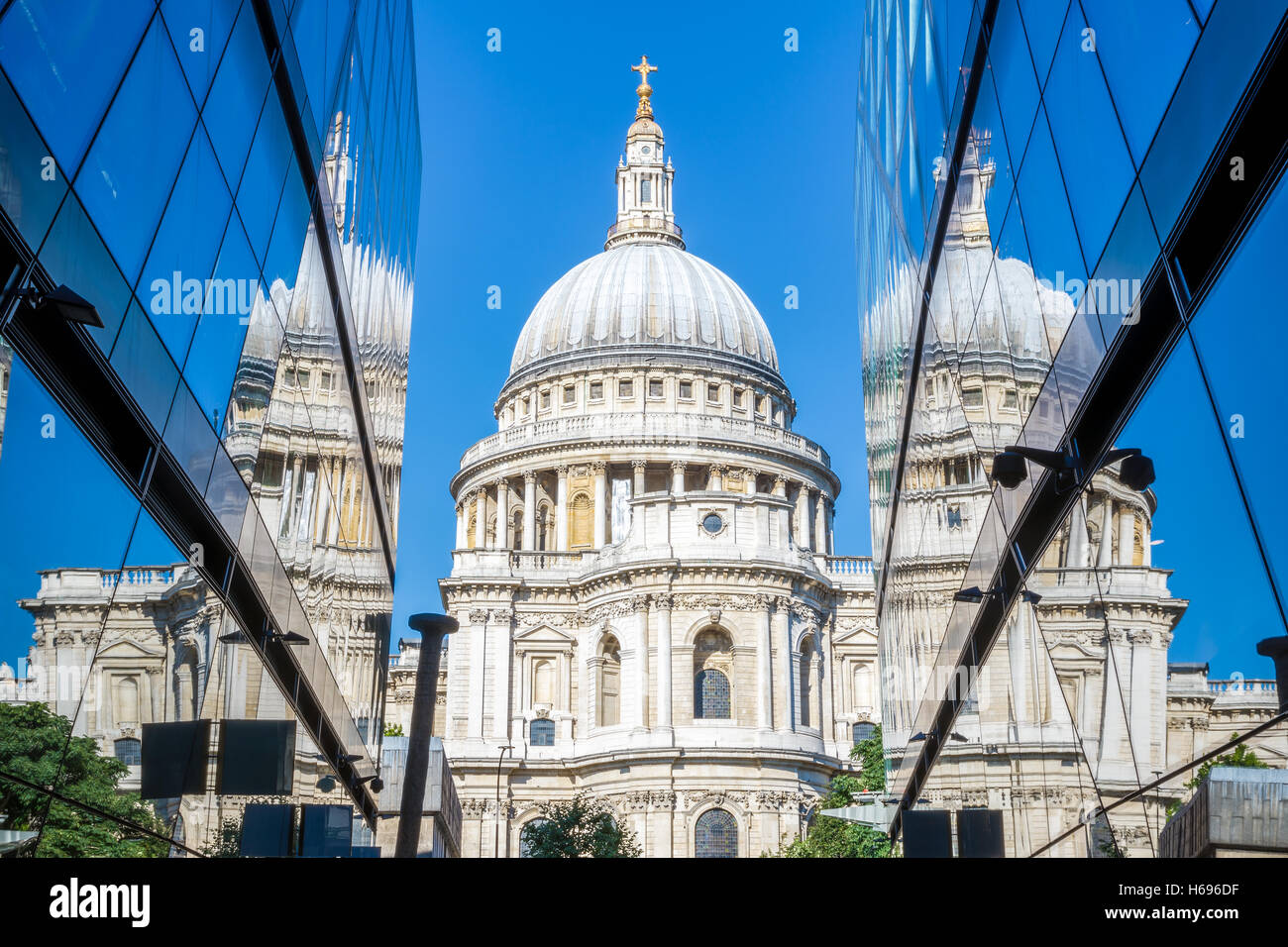 St Pauls Cathedral and its reflection from glass walls of One New Change building in London - Stock Image