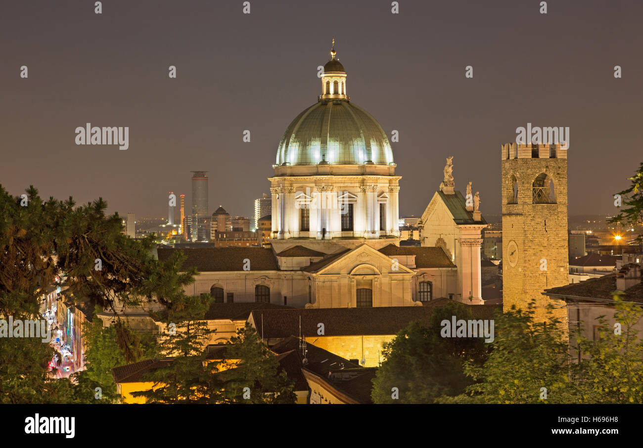 Brescia - The Duomo cupola over the town at night. - Stock Image