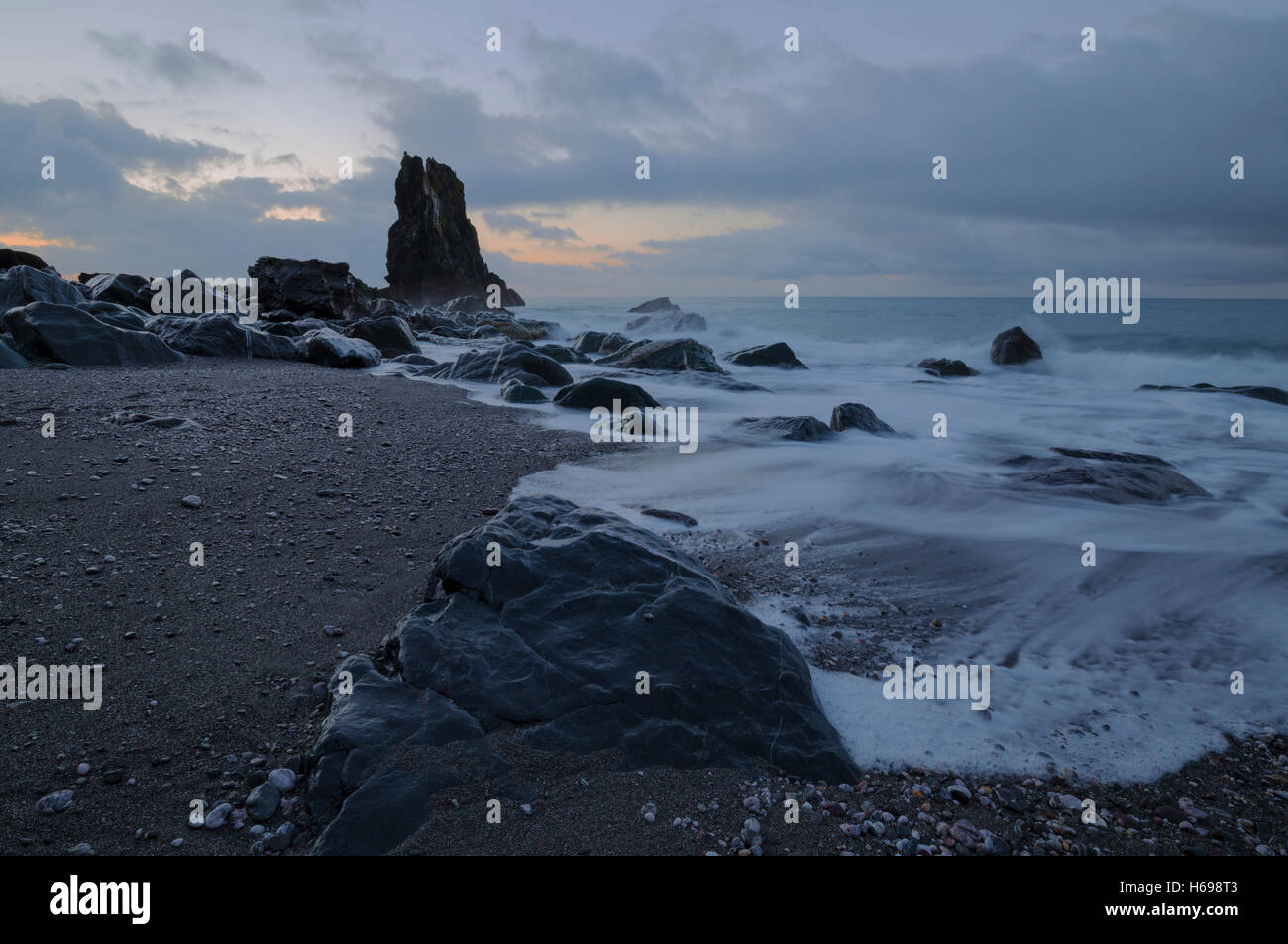First light of a new day at Shag Rock near Downderry Cornwall - Stock Image